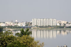 Hussein Sagar lake, Hyderabad. View from Necklace Road across the large lake Hussein Sagar in Hyderabad, India.  Sanjeevaiah Park in Secunderabad is on the Royalty Free Stock Photography