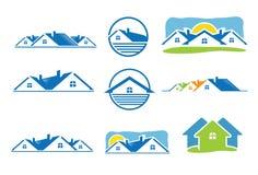 Hussymbol och fastighetlogo Arkivfoto