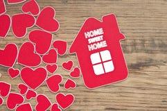 Hussymbol och små hjärtor. Arkivbild