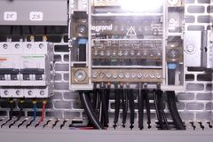 Image shows control cubicle. Schneider circuit breakers and Legrand electric device inside power case. Royalty Free Stock Photos
