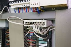 Image shows control cubicle. Schneider multimode fiber switch and Schneider circuit breakers inside power case. Royalty Free Stock Photography