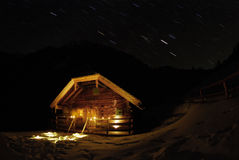 Hut. Shelter in austrian mountain at night, long-term exposure, you can see the rotation of the earth (stars in the background Stock Photos
