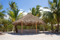 Hut. Beautiful hut with palm tree roof on the beach Stock Images