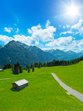 Hut and alpine landscape Royalty Free Stock Images