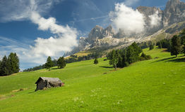 Hut in alpine meadow Stock Photography