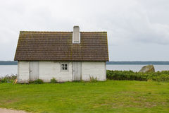 Hut ashore. The house standing on the coast of the gulf Stock Image