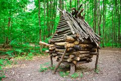 Hut of Baba-Yaga in the forest, barn of twigs, wooden hut, hut on chicken legs stock image