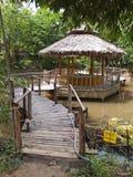 Hut and bamboo bridge Royalty Free Stock Images