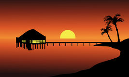 Hut in beach landscape. At the sunset with sun Royalty Free Stock Photo