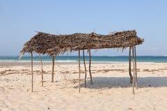 Hut on the beach near Indian Ocean. Empty hut on the beach near Indian Ocean in Kenya Stock Photo
