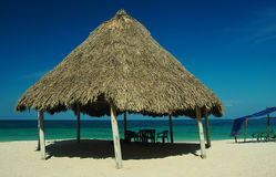 Hut on Beach, Playa Blanca, Colombia. Shadow giving hut at a white sand beach near Cartagena in Colombia stock images