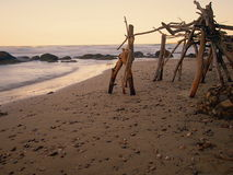Hut on the beach at sunset. Feature hut consists of trunks and branches on a beach Stock Images