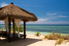 Hut at beach and turquoise sea on island. Gili Islands royalty free stock photo