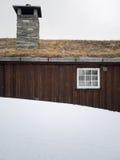 Hut behind snowdrift Royalty Free Stock Photo
