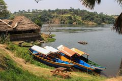 Hut and boat on the shore of the Nile River stock image