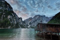 Hut on Braies lake and Dolomiti on sunrise Royalty Free Stock Images