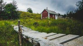 Hut. And bridge at the lake Stock Image