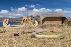 Hut and canoe boat at Uros floating island and village on Lake Titicaca near Puno,  Peru Stock Photos