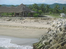 Hut in Caribbean fishing village. Thatched hut on sandy in Caribbean fishing village Stock Photo