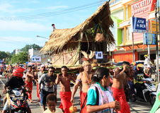 Hut carried by men from Doreri. Traditional hut carried on shoulders of men from group Doreri in traditional clothes in procession in occasion of celebration of Stock Photo