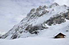 Hut at collac peak in winter, dolomites Stock Photography