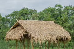 Hut in the countryside Asia roofed with Thatched. Royalty Free Stock Photo