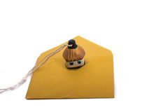Hut by the envelope. Little Ukrainian hut maket placed on an envelope Royalty Free Stock Photos