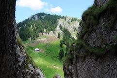 Hut faraway in the mountains. Scenery in the Carpathians mountains, Romania, Buila - Vanturarita National Park Stock Photo
