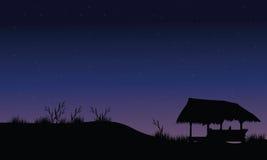 Hut in field scenery Stock Image