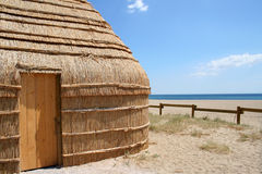 Fishing hut in Port Barcares, France. Thatched hut of fisherman on beach in Port Barcares, France on sunny day stock photography