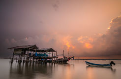 Hut and fishing boat on laemsai beach Royalty Free Stock Photo