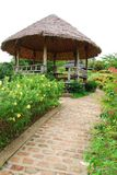 Hut and flower in garden. They are hut and flower in garden.this place is in south of thailand Stock Photo