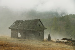 Hut in a foggy morning stock images