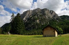 A hut in front of a mountain in the Dolomites Royalty Free Stock Photo