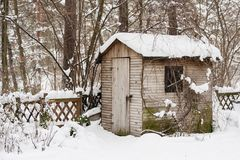 Hut in a garden in winter Royalty Free Stock Images