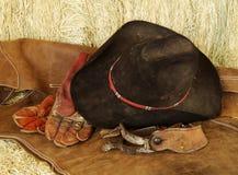 Hut, Handschuhe und Sporne Lizenzfreie Stockbilder