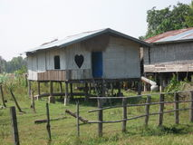 Hut with heart shaped window. Hut in Laos with heart shaped window Royalty Free Stock Photo