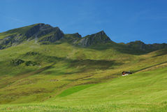 Hut and high mountains near Tenna, Switzerland Royalty Free Stock Image
