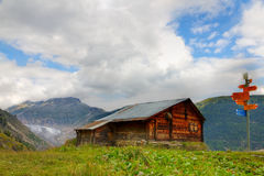 hut and hiking signpost, Switzerland Royalty Free Stock Image