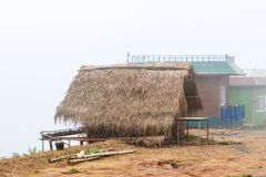 Hut and house under mist in the morning at Phu Tub Berk, Petchabun Thailand.  stock photography