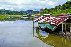 Hut on lake after rains Stock Images