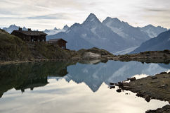 Hut on a lake reflection stock images