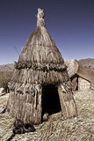 Hut lake titicaca. Old hut on floating uros reed bed islands on lake titicaca, Peru Stock Photo