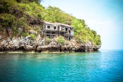 Hut on a limestone cliff in the Andaman Sea Stock Photo