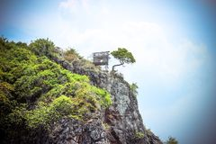 Hut on a limestone cliff in the Andaman Sea Royalty Free Stock Image
