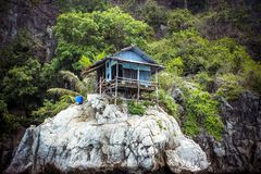 Hut on a limestone cliff in the Andaman Sea Stock Photos