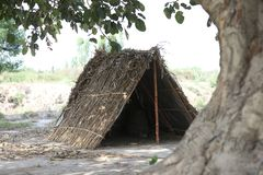 Hut made of husk and bamboos stock images