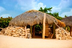 A hut made of stone and thatched roof. Stock Images