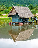 Hut midstream on river Stock Image