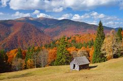 Hut in a mountain forest. Autumn Landscape Royalty Free Stock Photography